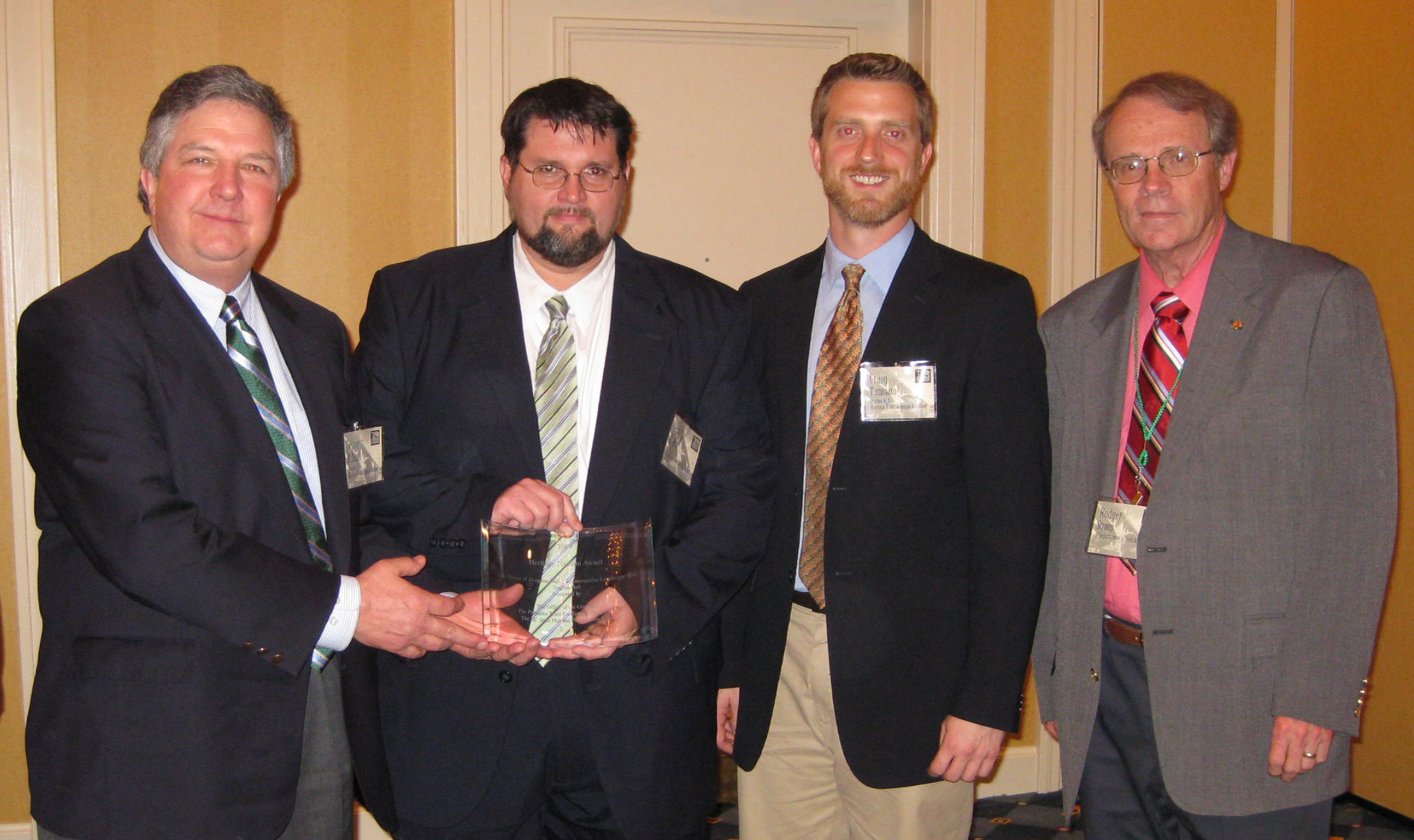 (From L to R) Executive Director George McDaniel and Scott English, chief of staff for Governor Mark Sanford, hold Drayton Hall's Heritage Tourism Award, with Director of Museum Interpretation Craig Tuminaro and Rodger Stroup, director of the SC Department of Archives and History.