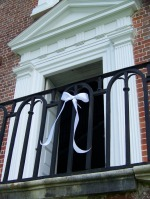 As a tribute to Philip Simmons, white ribbons adorn the ironwork he helped to shape, at Drayton Hall and throughout the area.
