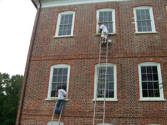 While work continues on the portico, preservation craftsmen will be repainting and repairing the historic windows.