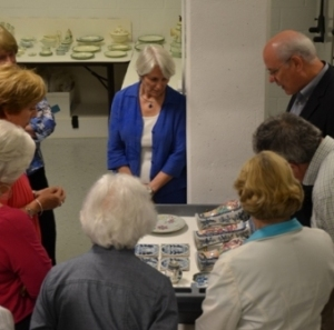 Viewing a selection of newly conserved Drayton porcelain objects that will in included in the exhibit.