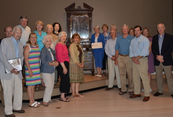 The Drayton Hall group at the preview; the author, in blue, stands next to the newly conserved Bureau Bookcase.