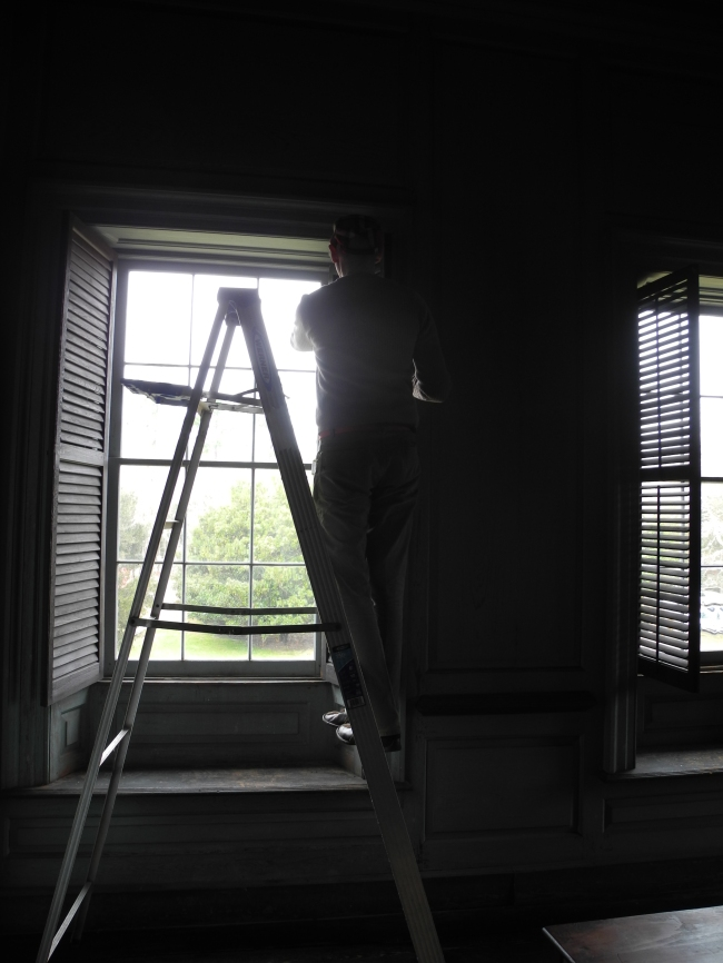 Eric dusting the Victorian louvered shutter blinds and removing any cobwebs.