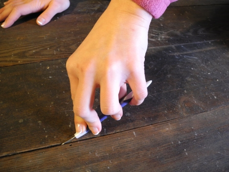 We use dental picks to clean the space between the floor boards.