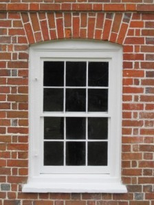 This basement window was repaired by our preservation department in 2013 and shows how the new sashes will look in the other basement window openings.